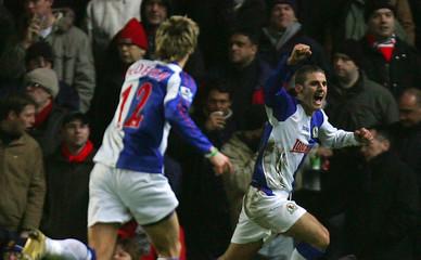 Blackburn Rover's Bentley celebrates with Pedersen after scoring against Manchester United in Blackburn