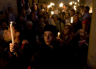 Worshippers hold candles in the Church of Holy Sepulchre during a Christian Orthodox Holy Fire ceremony in Jerusalem's Old City