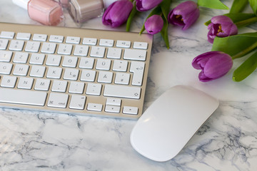 Woman office desk with Spring blossom flowers, tulips on white background top view mockup