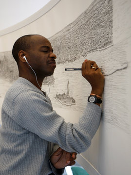 British artist Stephen Wiltshire works on a hand-drawn panorama of the skyline of New York, from a studio at the Pratt Institute in Brooklyn