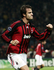 AC Milan's Gilardino celebrates scoring a second goal against Shakhtar Donetsk during their Champions League match in Milan