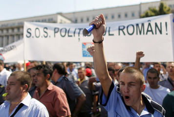 A policeman shouts slogans during a protest of the policemen trade union in Bucharest