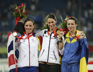 Silver medallist Fell of Britain, gold medallist Schoneborn of Germany and bronze medallist Tereshuk of Ukraine pose during medal ceremony of the modern pentathlon competition at the Beijing 2008 Olympic Games