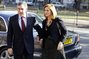 Britain's Prime Minister Gordon Brown arrives with his wife Sarah at the Baptist church in Brighton,