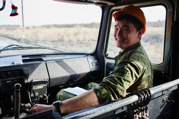 Portrait of a man, a firefighter, an Asian-Kazakh at work