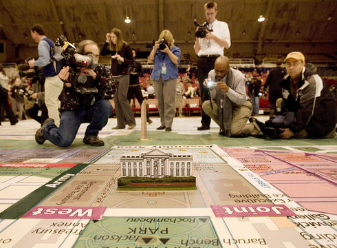 Members of the media surround a 40 foot square logistics planning map for the inauguration of President Barack Obama at the DC Armory in Washington