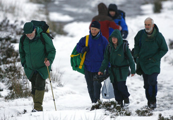 Surviving members of a climbing party return to their vehicles at the base of Buachaille Etive Mor in Glencoe in northern Scotland