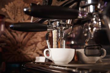 Coffee machine in a cafe pours fresh espresso