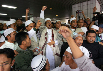 Leader of the Islamic Defenders Front Muhammad Rizieq and supporters of Indonesian Muslim cleric ...