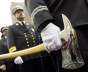 FIREFIGHTER HOLDS AXE DURING GATHERING WITH COLLEAGUES FROM AROUND THEWORLD IN NEW YORK.