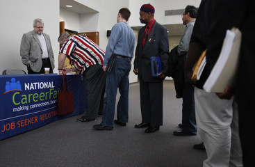 People wait in line to sign in at the Dallas Military/Veteran Career Fair in Dallas