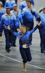 A member of Australia's Olympic team gestures during the opening ceremony of the Beijing 2008 Olympic Games at the National Stadium