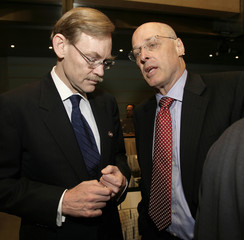 U.S. Treasury Secretary Paulson talks to World Bank President Zoellick at the Development Committee meeting