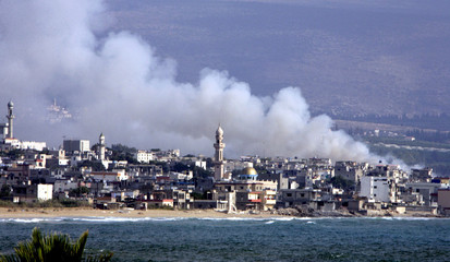 A view of smoke raising over Alaamreya, near Southern Lebanon's town of Tyre (Soure), after an Israe..