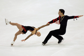 PAIRS SKATERS LANGLOIS AND ARCHETTO DURING SKATE CANADA SHORT PROGRAM.