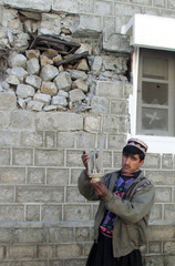 A KASHMIRI MAN SHOW MORTAR SHELL IN PAKISTAN HELD KASHMIR.