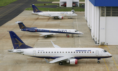 Embraer's commercial jet models 175, 145 XR and 170 sit next to a hangar at their factory in Gaviao Peixoto