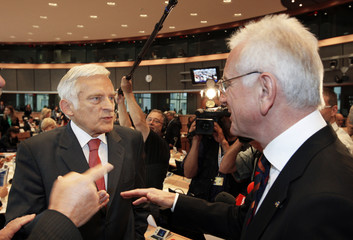 Conservative EPP candidate to be the new president of the European Parliament, Buzek, talks with the current President Poettering during a party meeting in Brussels
