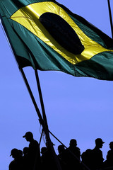 BRAZILIAN SOLDIERS BENEATH THEIR FLAG UPON DEPARTURE TO HAITI AT START OF UN PEACEKEEPING MISSION.