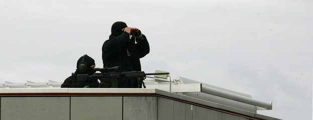 Two German special police sniper observe the Holocaust memorial site during the arrival of Israeli ...