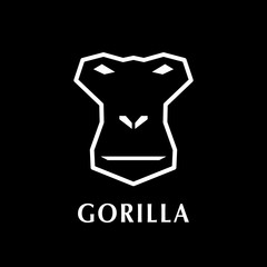 Gorilla head logo element. On black background.
