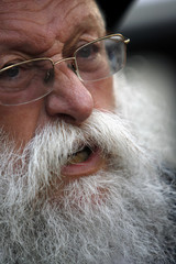 Rosenberg, grandfather of orphaned two-year-old Holtzberg reacts during a condolence prayer meeting in Mumbai