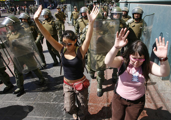 Chilean students put their hands in the air during a protest in Valparaiso city