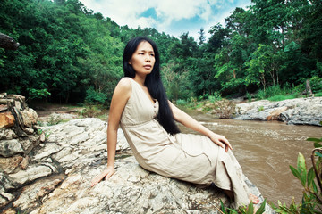Asian woman in natur
