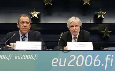 Russia's Foreign Minister Sergei Lavrov (L) speaks during a joint news conference with his Finnish counterpart Erkki Tuomioja after an EU-Russia Permanent Partnership Council meeting in Brussels