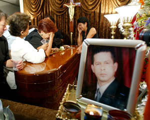 NELLY CARRERA MOURN OVER HER HUSBAND'S COFFIN IN LIMA.