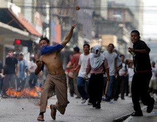 Protesters throw rocks and bottles at police during demonstration against trade pact with the US ...