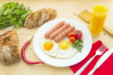 Foto op Canvas Gebakken Eieren Fried eggs and fried sausage for breakfast.