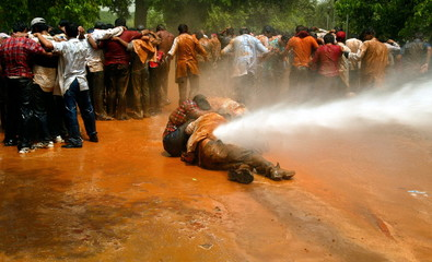 Indian police use water cannon to disperse medical students during a protest in New Delhi May 12, 20..