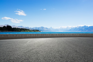 empty road with blue sea in blue sky