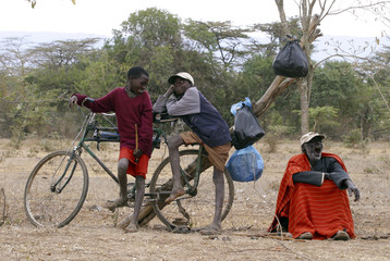 Residents wait to receive food rations from the United Nations WFP following prolonged drought at camp in Laikipia