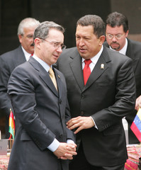 Presidents from Colombia Uribe and from Venezuela Chavez at summit in Cuzco.