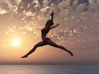 Yes, I can fly. Sunset at the ocean with young women jumping into the water