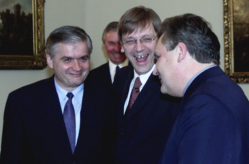 BELGIAN PRIME MINSTER SHARES A LIGHT MOMENT WITH POLISH PRESIDENT.