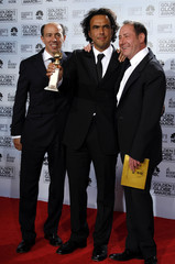 Babel producers and director Inarritu smile after winning the Golden Globe for Best Motion Picture - Drama at the 64th annual Golden Globe Awards in Beverly Hills