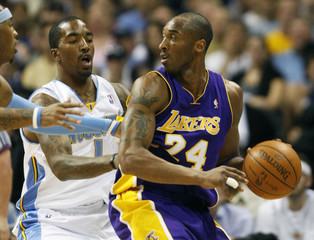 Lakers Bryant  is doubleteamed by Nuggets guard Smith and guard/forward Jones in the first quarter during Game 6 of the NBA Western Conference Finals basketball game in Denver