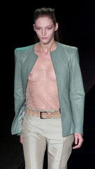 A MODEL WEARS JOOP! JACKET OVER SEE THROUGH BLOUSE.