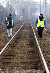 French railway maintenance workers inspect a section of track between Toulouse and Montauban, southw..