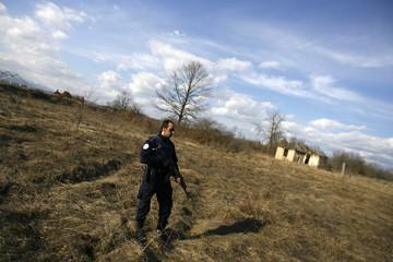 A Kosovo policeman takes position near the site of a Serbian protest at the Gate 3 border post near Podujevo in Kosovo