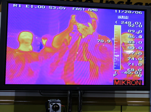 An infrared image is seen on a monitor in a booth showing off a burglar alarm system at the 2007 International CES in Las Vegas
