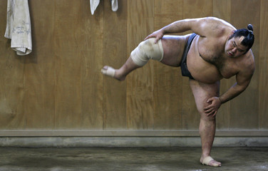 Sumo wrestler does sumo squats during morning practice at Musashigawa stable in Tokyo