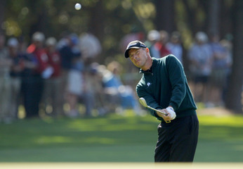 Hansen of Denmark chips onto the first green during first round play at the 2009 Masters golf tournament in Augusta
