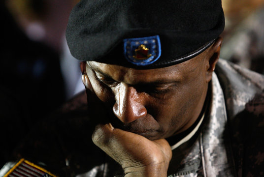 Tears stream down US Army Sgt  Walker Jr.'s face during a candle light vigil at Hood Stadium on the Fort Hood Army Post in Fort Hood