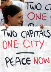 """LEFT WING DEMOSTRATOR HOLDS SIGN """"TWO CAPITALS IN ONE CITY"""" IN JERUSALEM."""