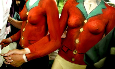 Two pro hunt campaigners, with their bodies painted in traditional hunting uniforms, arrive for a ra..