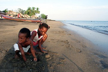 Four-year-old Juan (L) and his sister nine-year old Claudia Gonzalez play in the sand in Panama Dari..